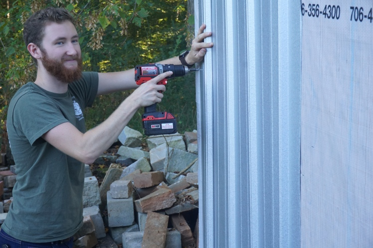 Noah making sure the the siding stays put.